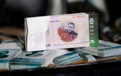 En un barrio venezolano crean moneda con imagen de Chávez